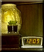 A clock on a shelf to represent the flow of time